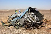 A plane part is seen as the Egyptian officials inspect the crash site of Russian Airliner in Suez Egypt on November 01 2015 A Russian Airbus321...