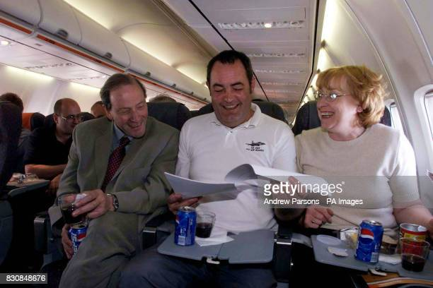 plane spotters Paul And Lesley Coppin go though their papers with Stephen jakobi director of Fair Trials Abroad on their flight to Athens from Luton...