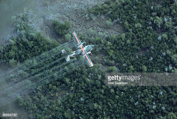 UC 123K plane spraying delta area w dioxintainted herbicide/defoliant Agent Orange in Vietnam war defensive measure 20 MI SE OF SAIGON