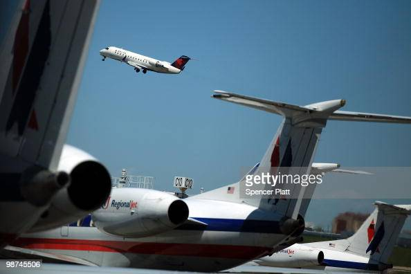 A plane takes off at LaGuardia Airport on April 29 2010 in New York New York Beginning today a new Department of Transportation rule will fine...