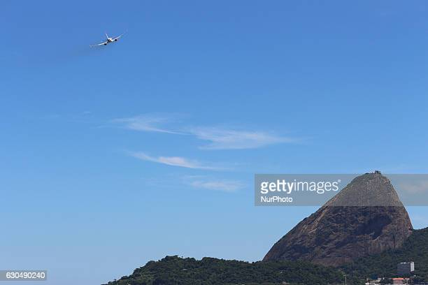 Plane takes off at Santos Dumont Airport in Rio de Janeiro Brazil on 23 December 2016 with Sugar Loaf in the background With the festivities of...