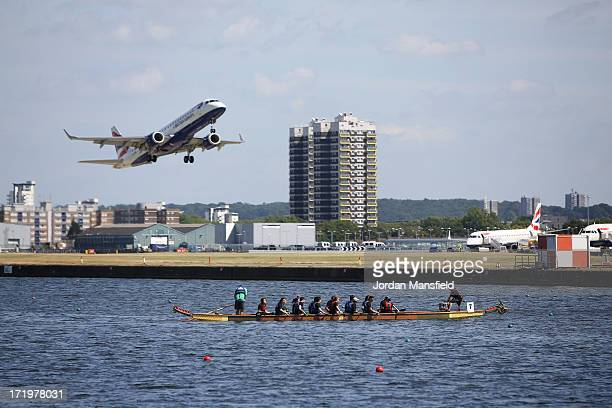 A plane takes off from London City Airport over the dragon boats on June 30 2013 in London England The London Hong Kong Dragon Boat Festival has been...
