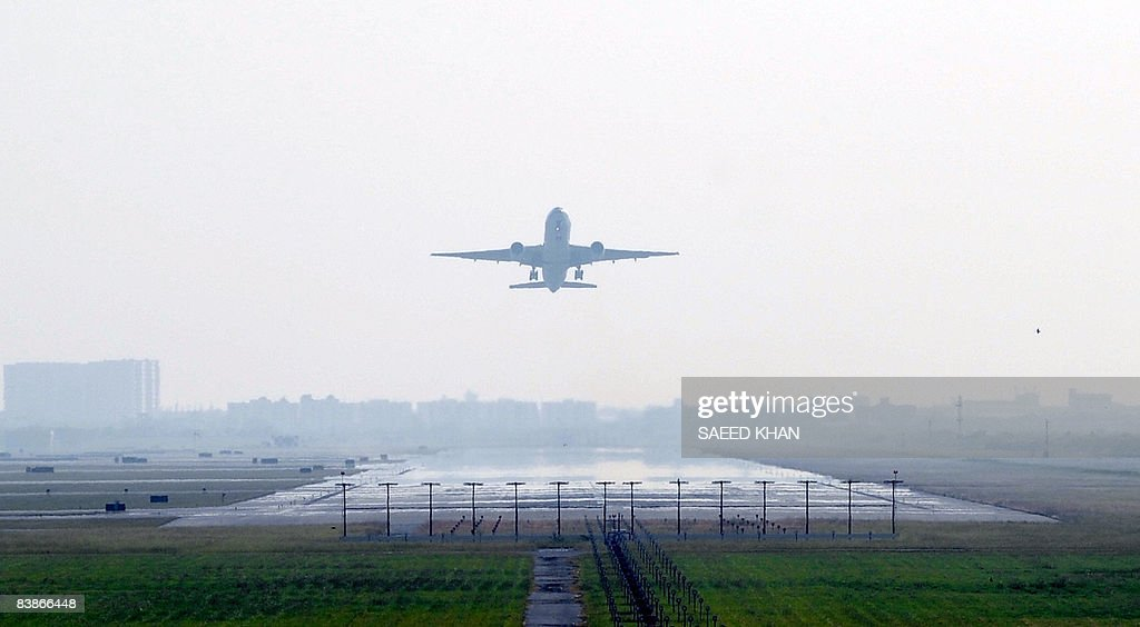 A plane takes off from the besieged Suvarnabhumi international airport in Bangkok on December 01 2008 Antigovernment protesters have allowed 37 empty...