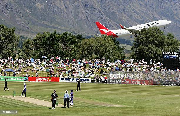 A plane takes off from the nearby airport during the first One Day International match between New Zealand and Sri Lanka at the Queenstown Events...