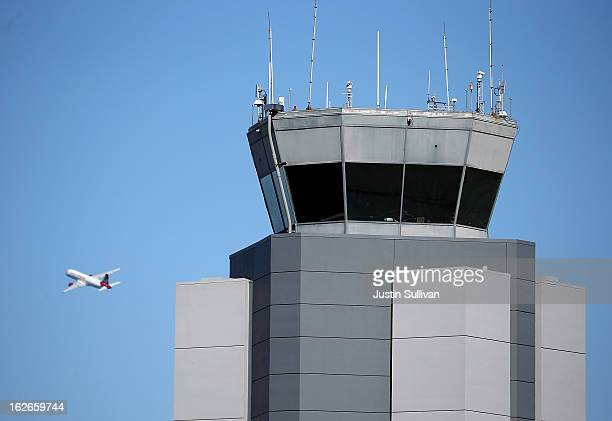 A plane takes off past the control tower at San Francisco International Airport on February 25 2013 in San Francisco California The impending federal...