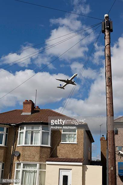 A plane taking off from Londons Heathrow Airport and flying over the Hatton Cross area of Hounslow Borough