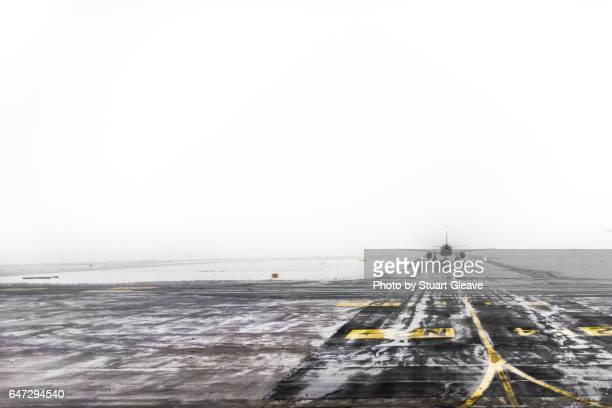 Plane taking off in to dense fog