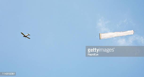 Plane towing blank banner