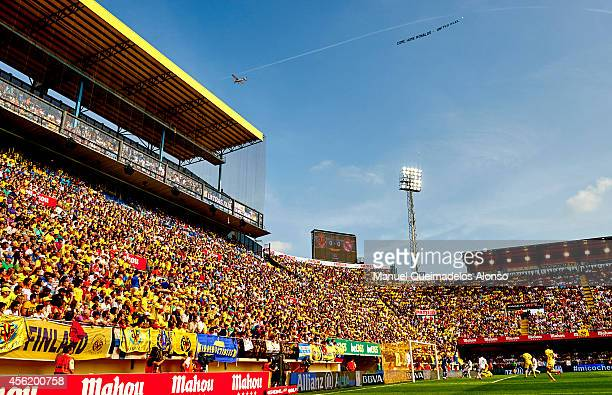 A plane tows a banner reading 'Come home Ronaldo United Reel' during the La Liga match between Villarreal CF and Real Madrid at El Madrigal on...