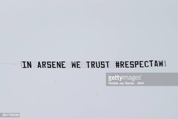 A plane tows a banner supporting Arsene Wenger during the Premier League match between West Bromwich Albion and Arsenal at The Hawthorns on March 18...