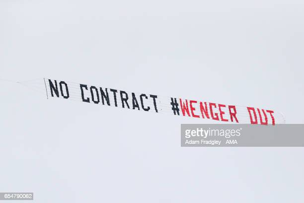 A plane tows a Wenger out banner during the Premier League match between West Bromwich Albion and Arsenal at The Hawthorns on March 18 2017 in West...