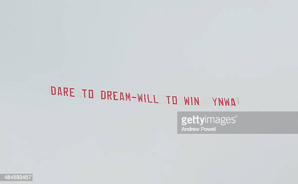A plane with a banner displaying the message 'Dare to dream will to win YNWA' in support of Liverpool flies over ground during the Barclays Premier...