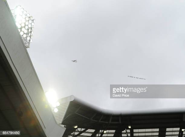 A plane with a banner over the stadium during the Premier League match between West Bromwich Albion and Arsenal at The Hawthorns on March 18 2017 in...