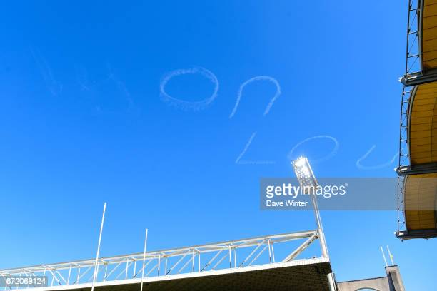 A plane writes Lyon LOU in the sky during the European Champions Cup semi final match between AS Clermont and Leinster on April 23 2017 in...