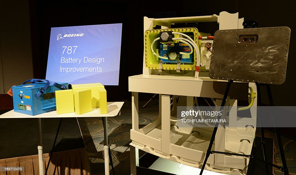 US planemaker Boeing displays an 'improved' 787 battery (L) and its titanium-made case (R) during a press conference in Tokyo on March 15, 2013. The grounded Dreamliner is 'absolutely' safe and will be back in the air within weeks, planemaker Boeing said in Japan, as it sought to reassure airlines and fliers about its aircraft.