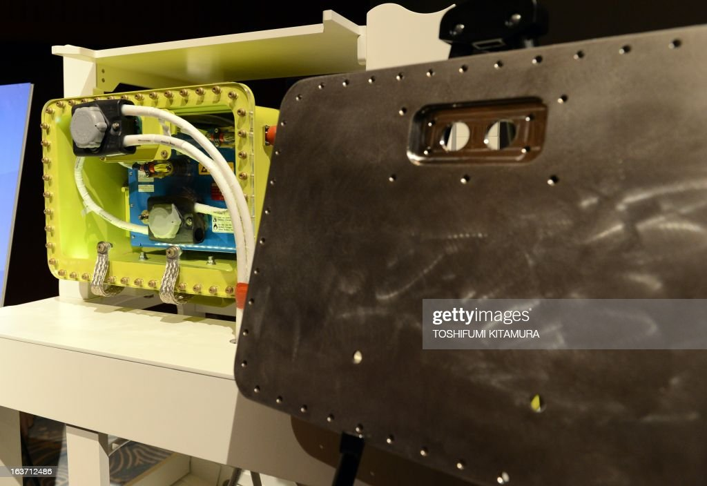US planemaker Boeing displays an 'improved' 787 battery and its titanium-made case during a press conference in Tokyo on March 15, 2013. The grounded Dreamliner is 'absolutely' safe and will be back in the air within weeks, planemaker Boeing said in Japan, as it sought to reassure airlines and fliers about its aircraft.