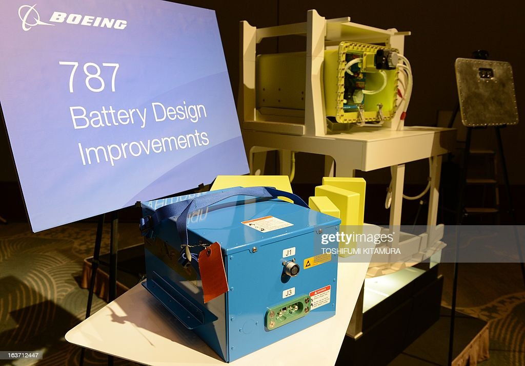 US planemaker Boeing displays the 'improved' 787 battery (front) and its titanium-made case (rear) during a press conference in Tokyo on March 15, 2013. The grounded Dreamliner is 'absolutely' safe and will be back in the air within weeks, planemaker Boeing said in Japan, as it sought to reassure airlines and fliers about its aircraft. AFP PHOTO / TOSHIFUMI KITAMURA