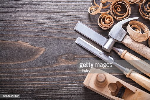 Planer claw hammer metal firmer chisels and wooden curled shavin : Stock Photo