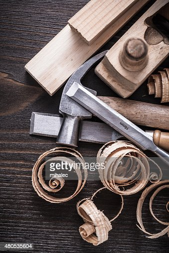 Planer hammer chisels wooden studs and curled shavings on vintag : Stock Photo