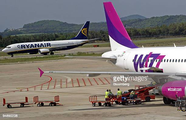 Planes belonging to lowcost airlines Ryanair and Wizz Air prepare to take off from Gerona International Airport in Gerona Spain Frdiay September 2004