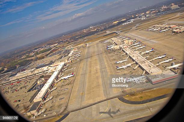 Planes consisting mostly of Delta Air Lines jets sit at their gates as seen from a departing flight at HartsfieldJackson International Airport in...
