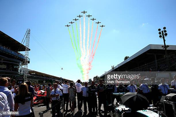 Planes fly over the grid before the Formula One Grand Prix of Italy at Autodromo di Monza on September 6 2015 in Monza Italy