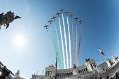 Planes of the Italian Air Force aerobatic unit Frecce Tricolori spreads smoke with the colors of the Italian flag over the Vittoriano Unknown Soldier...