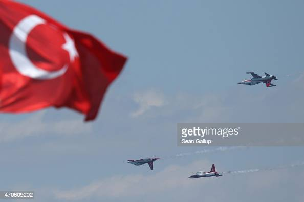 Planes of the Turkish air force fly in formation past a Turkish flag at Helles Point where Allied soldiers fought during the Gallipoli Campaign...