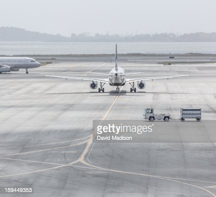 Planes on airport runway : Stock Photo