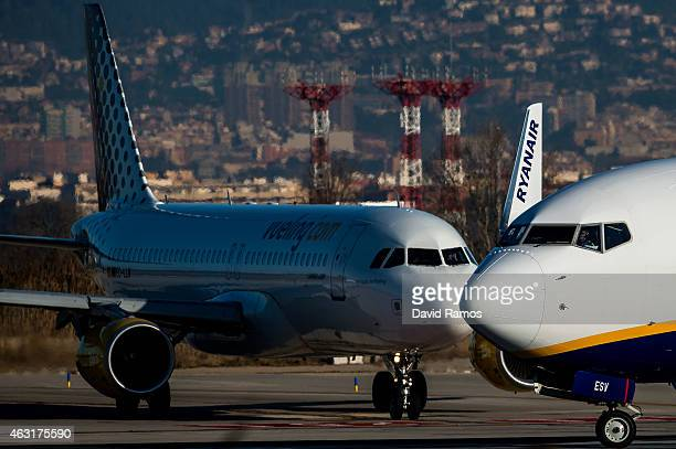 Planes operated by Vueling and RyanAir are seen at Aena operated Barcelona El Prat International Airport on February 10 2015 in Barcelona Spain...