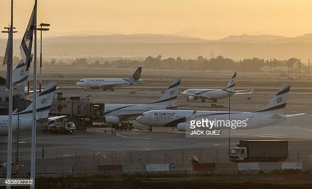 Planes sit on the tarmac at Ben Gurion International airport near the Mediterranean Israeli coastal city of Tel Aviv on August 21 following a warning...