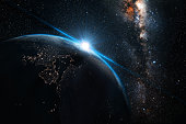 blue sunset, view of earth from space with milky way galaxy