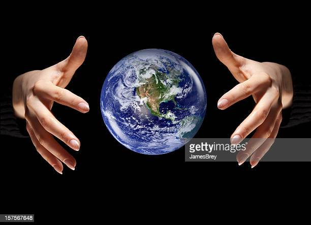 Planet Earth Floating Between Nurturing, Protective Hands, Black Space Background