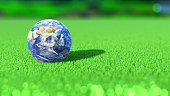 Planet Earth on the green of a golf course. India. 3D rendering.
