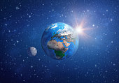 Planet Earth in deep space, focused on Europe, Africa and Asia, with the moon and the sun. 3D illustration (composed with Blender software). Elements of this image furnished by NASA (http://eoimages.g