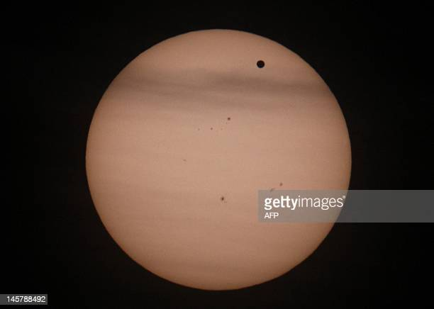 Planet Venus transits in front of the Sun seen from the the Urania observatory in Vienna on June 6 2012 Astronomers and novice stargazers worldwide...