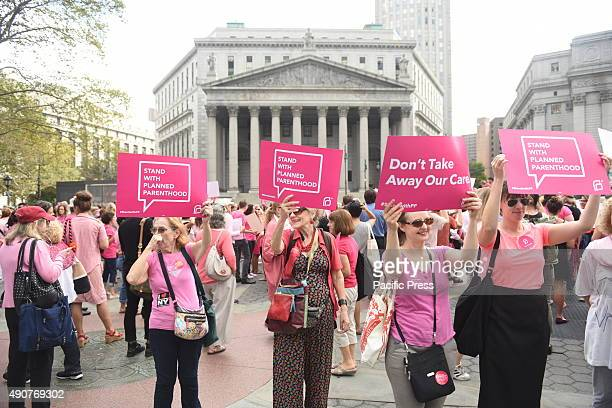 Planned Parenthood activists in pink hold signs in front the US courthouse Activists and directors of Planned Parenthood NYC gathered in Foley Square...