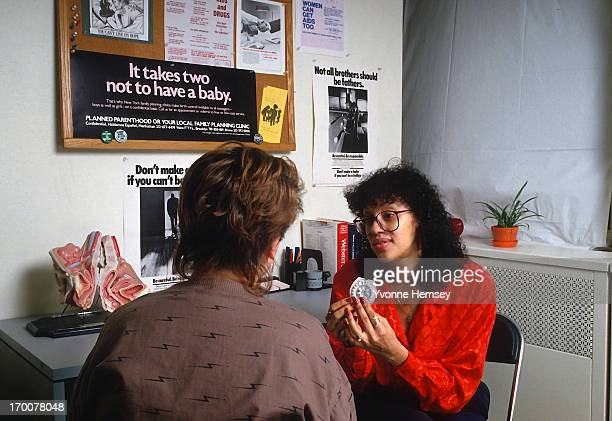 Planned Parenthood counselor advices a young woman about contraceptives February 3 1988 In New York City