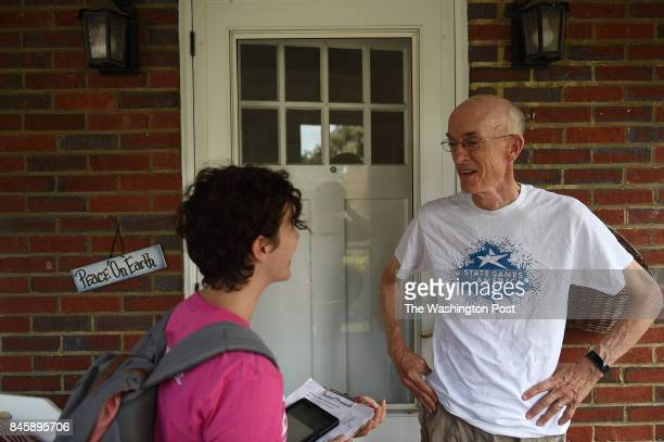 Planned Parenthood volunteer Kate Steir left from Arlington VA talks to voter Andy Leighton at his home in Arlington VA August 19 while canvassing...