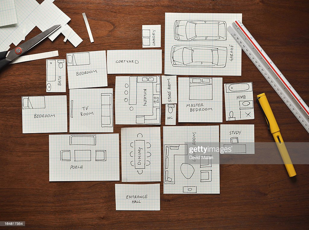 Planning a home using graph paper. : Stock Photo