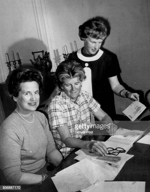 Planning a Ski Party in the Spring Making plans for a party honoring noted ski instructor Willy Schaeffler are from left Mrs Claude Maer Jr Mrs John...