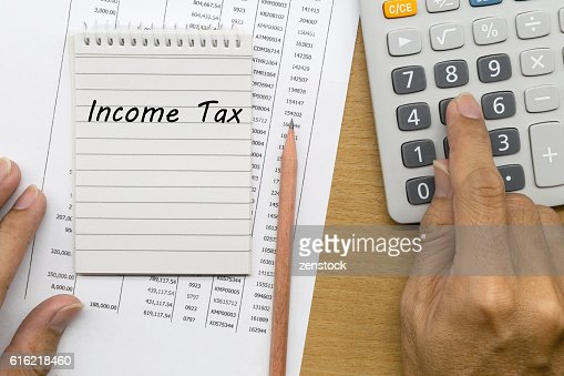 Planning monthly income tax : Stock Photo