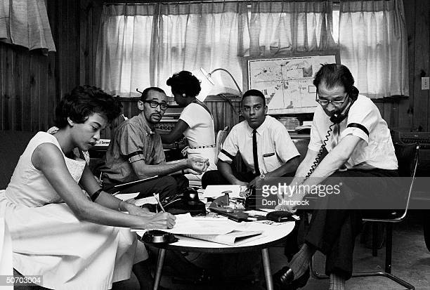 A planning session of members the Albany Movement a group working to elimibate discrimination in Albany Georgia July 1962 Clockwise from near left...