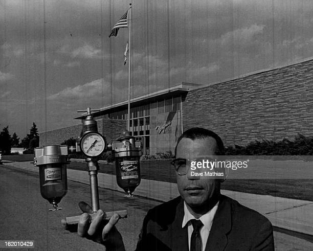 SEP 19 1962 SEP 26 1962 Plant Manager Paul Williams displays one of C A Norgren's famous products a combination airline filter pressure regulator and...