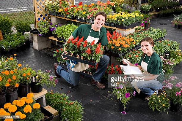 Plant nursery retail store worker taking inventory