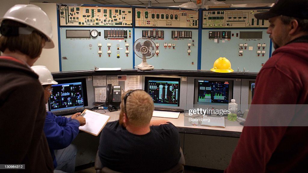 Plant operators and other Michigan Sugar Co. employees talk in the control room of the plant where sugar beets are turned into molasses and white crystalized sugar in Bay City, Michigan, U.S., on Monday, Oct. 24, 2011. U.S. sugar supplies this year will fall to the lowest since record-keeping began in 1960 as consumption rises and a smaller beet crop limits supplies left from last season, according to a U.S. Department of Agriculture report released earlier this month. Photographer: Adam Bird/Bloomberg via Getty Images