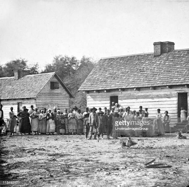 Plantation slaves gathered outside their huts Virginia America Photograph c1860