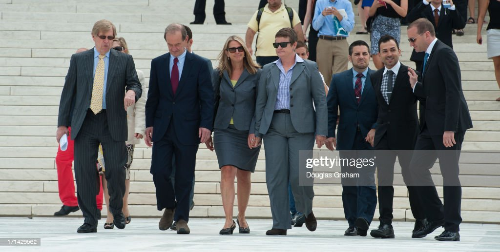 Plantiffs in the Proposition 8 court battle before the Supreme Court Sandy Stier, Kris Perry, Paul Katami and Jeffrey Zarrillo walk away from the court with attorney Ted Olson and Human Rights Campaign President Chad Griffin (R) June 20, 2013 in Washington, DC. The Supreme Court is expected to release its decision on the case next week.