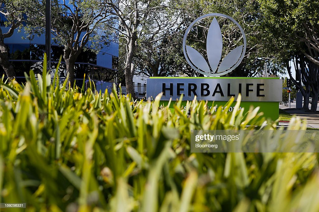 Plants stand in front of Herbalife Ltd. signage displayed outside of the company's corporate headquarters in Torrance, California, U.S., on Thursday, Jan. 10, 2013. Daniel Loeb is squaring off against Bill Ackman over the future of Herbalife Ltd. By taking an 8.2 percent stake in the direct seller of nutrition shakes, Loeb's Third Point LLC is the latest firm to reject hedge fund manager Ackman's theory that Herbalife is a pyramid scheme. Photographer: Patrick Fallon/Bloomberg via Getty Images