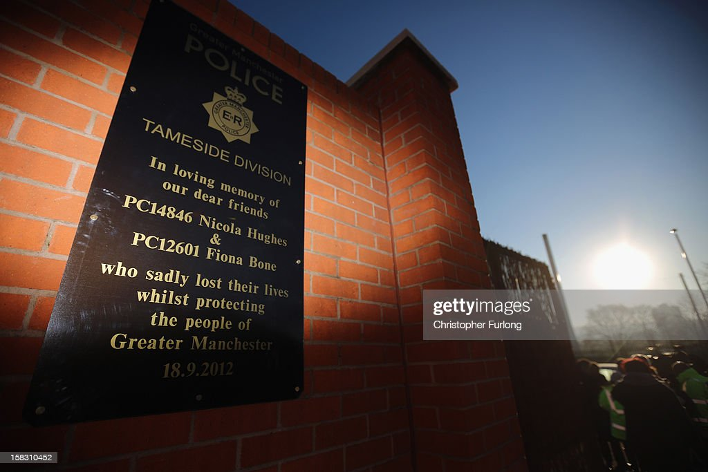 A plaque adorns the wall of the memorial garden dedictated to murdered PC's Fiona Bone and Nicola Hughes, which was unveiled today on December 13, 2012 in Hyde, England. Police Constables Fiona Bone, 32, and her colleague Nicola Hughes, 23, were killed as they responded to what they thought was a routine burglary call in Mottram, Greater Manchester and were murdered in a gun and grenade attack. The memorial garden outside Hyde police station has been created using funds donated by the public, businesses and police partners.